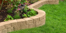 stone wall with perfect artificial grass SolReliable